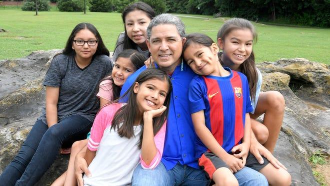 Charles Robinson with some of his eight children Rosie,13; Liyah,12; Aianli, 7; Imaiya, 9; Nanaiya, 11 and Tashka, 6, at a park near their Franklin home.