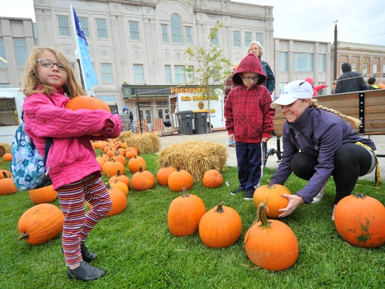 Picking pumpkins at the 2014 Harvest Fest at the 400