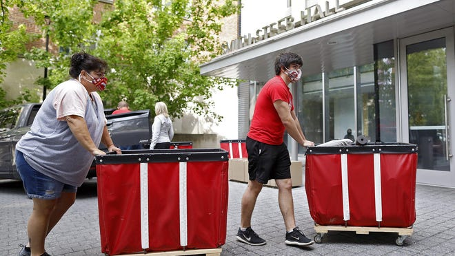 Freshmen Mason Bell, of Dover, moves into Ohio State's Smith-Steeb Hall e with the help of his mother, Tonya,  on Aug. 13, 2020. This year, Ohio State students are moving into their residence hall from Monday through Saturday.