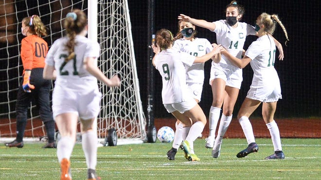 Canton's Elisa Diletizia and her teammates celebrate her goal against Oliver Ames on Wednesday.