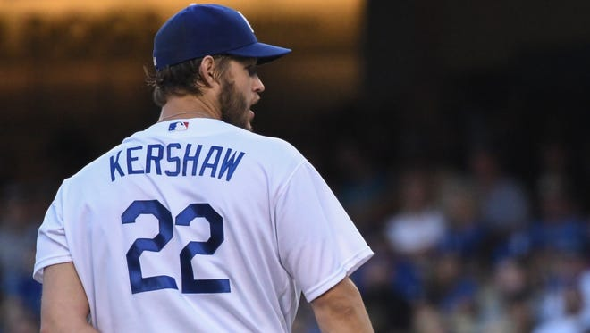 Jun 4, 2016: Los Angeles Dodgers starting pitcher Clayton Kershaw (22) looks for a sign from catch A.J. Ellis (not pictured) during the third inning against the Atlanta Braves at Dodger Stadium.
