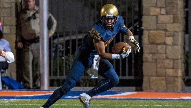 St. Thomas Aquinas Raiders wide receiver Trevon Grimes (16) runs with the ball against the Bishop Gorman Gaels during the second quarter at Fertitta Field