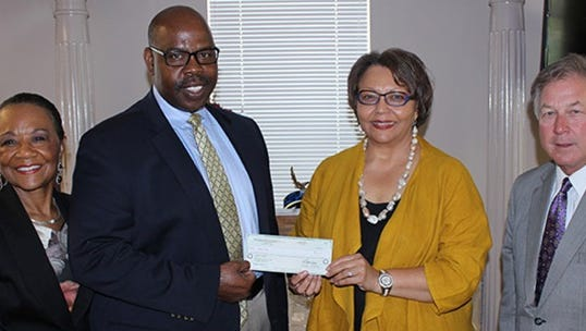 Mississippi Power Vice Presidents Moses Feagin (left) and John Atherton present Tougaloo College President Dr. Beverly W. Hogan (center) and Vice President of Institutional Advancement Dr. Deloris Bolden Stamps with a $10,000 check establishing the Heritage Scholarship.