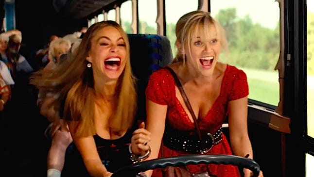 "Danielle (Sofia Vergara, left) is set to testify in a drug case, and it's up to Officer Cooper (Reese Witherspoon) to get her there safely in ""Hot Pursuit."""