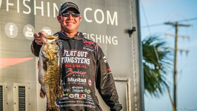 FLW Tour professional bass angler Brandon McMillan, of Clewiston, is all smiles after making the cut into the final 30 pros to fish Saturday in the FLW Tour season opener in Clewiston. Anglers are fishing for the top prize of $125,000.