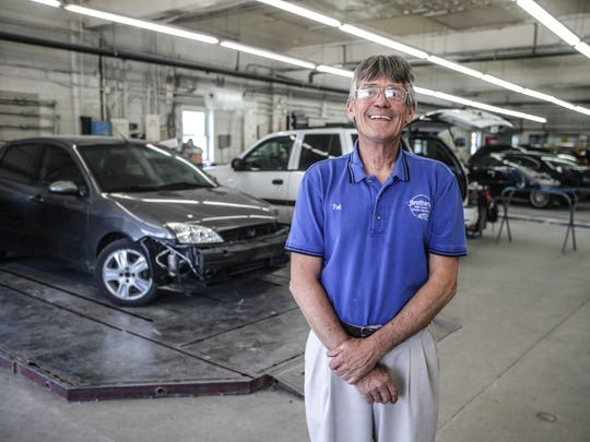 Patrick Johnson, owner of Brothers Body & Paint in Martinsville, Ind.,is shown standing inside the garage bay.  The shop is a member of the Indiana Autobody Association, which has filed suit against 12 insurance companies, alleging that the insurers violate antitrust laws.