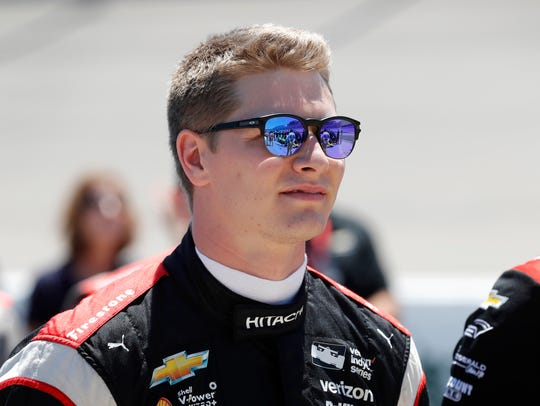 Josef Newgarden stands with teammates during the national