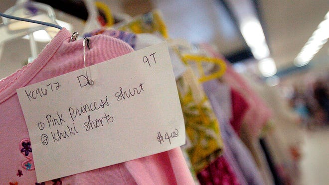 A tag is pinned on an item for sale inside Reruns are Fun.