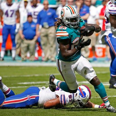 Miami Dolphins running back Jay Ajayi (23) runs ahead