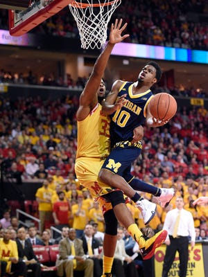 Michigan guard Derrick Walton Jr. drives to the basket during Sunday's loss at Maryland.
