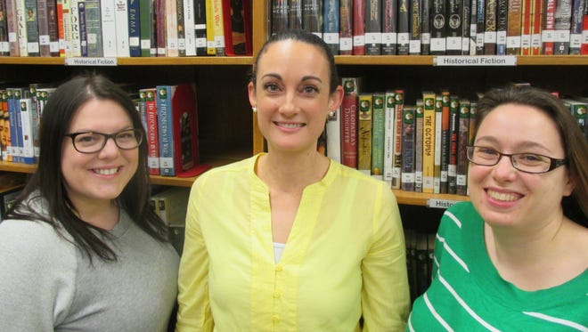 From left, Liz Peters, Allison Farmer and Kat Manion all participated in a recent inquiry research project. Farmer wrote the project and it was published in the April issue of Library Media Connection.
