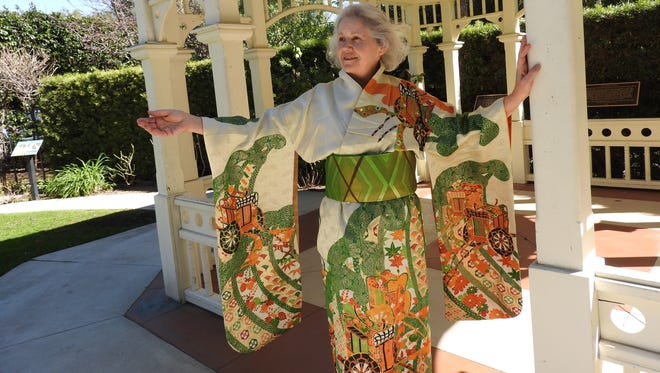 "Lynne Woods, a quilter for 40 years, models one of the kimonos that will be on sale at the 2018 Camarillo Quilters Association Quilt Show, ""Quilting by the Sea,"" April 13 and 14, at the Ventura County Fairgrounds. The vintage kimono has gold and green cording."