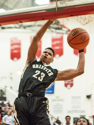 Tremell Murphy tears the rim down with a dunk Saturday night during the 2015 Class 3A Regional Championship at Kankakee Valley.