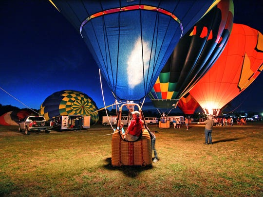 Roger Clark of Greer, pilot of The Sun Catcher, sits in his hot air balloon for a balloon glow at Balloons Over Anderson in October 2014.