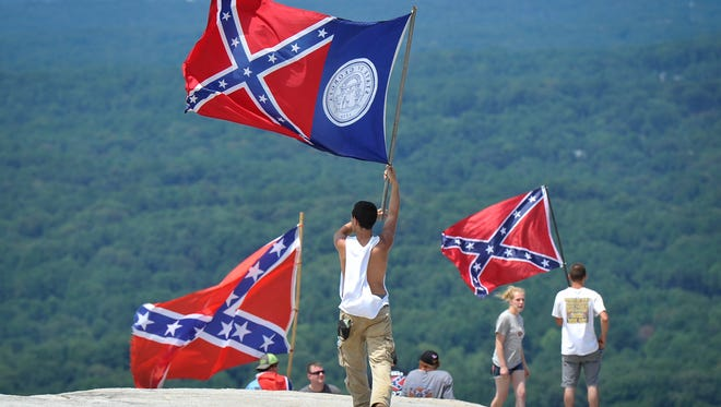 Confederate flag supporters demonstrate atop Stone Mountain as they protest what they believe is an attack on their Southern heritage during a rally at Stone Mountain Park in Stone Mountain, Ga., on Saturday, Aug. 1, 2015. (John Amis/Atlanta Journal-Constitution via AP) MARIETTA DAILY OUT; GWINNETT DAILY POST OUT; LOCAL TELEVISION OUT; WXIA-TV OUT; WGCL-TV OUT