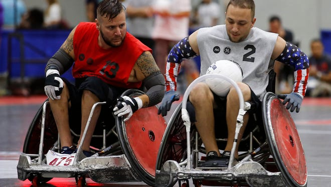 Two veterans participate in power soccer competition during the 37th National Veterans Wheelchair Games, Wednesday, July 19, 2017, at the Duke Energy Convention Center in Cincinnati.
