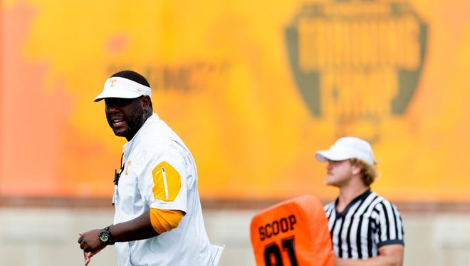 Tennessee offensive coordinator Larry Scott calls during Tennessee fall football practice at Anderson Training Facility in Knoxville, Tennessee on Friday, August 11, 2017.