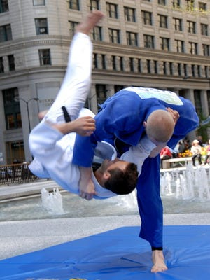 Fremont Ross graduate Myles Porter, top, competes at the 2012 International Judo Federation World Cup.