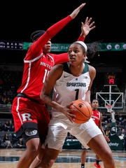 Michigan State's Sidney Cooks, right, maneuvers for a shot against Rutgers' Caitlin Jenkins Sunday, Dec. 31, 2017, in East Lansing, Mich.