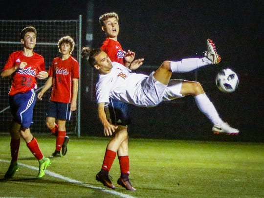 Blackman's Luke Buckley goes airborne on a shot attempt during Tuesday's Region 4-AAA semifinal win over Franklin County.