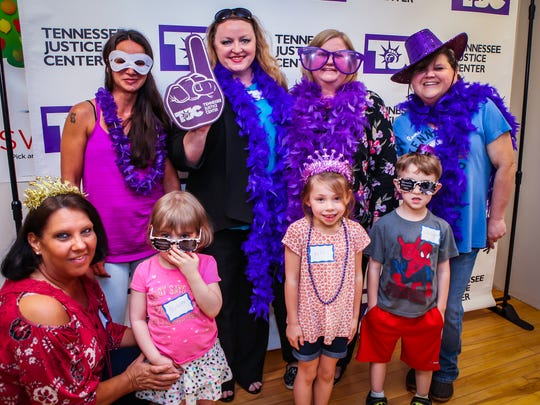Attendees pose in sponsor Tennessee Justice Center's photo booth at the Breakfast for Dinner kickoff celebration for the Breakfast in the Classroom program in Smyrna.