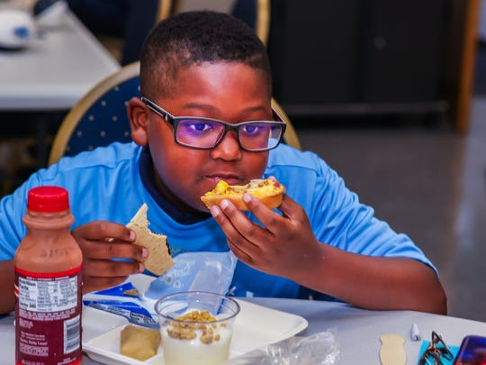 A Rutherford County student taste tests the menu for Breakfast in the Classroom at the Breakfast for Dinner kickoff celebration for the program in Smyrna.