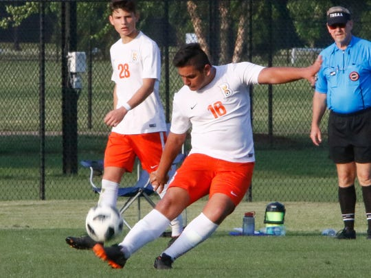 Mohammad Ali Khan gets a foot into the ball during Saturday's sectional win over Rhea County. Ali Khan scored a goal in the Blaze's 2-1 win.
