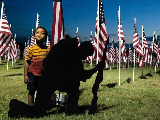 Andrew Wilson, 4, takes in the Healing Field on Saturday,