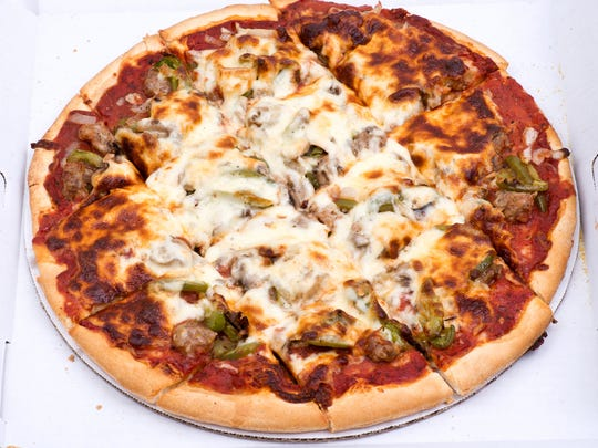 Chicago classic thin crust sausage, mushrooms, green peppers and onion pizza.