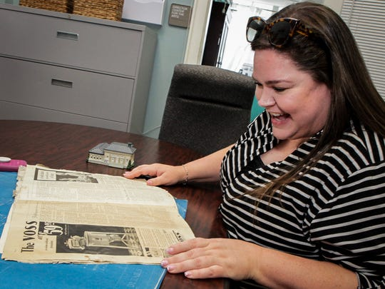 Patience Long reviews a copy of a 1931 copy of The Farmer's Wife Magazine recently found inside the Center for the Arts in downtown Murfreesboro.