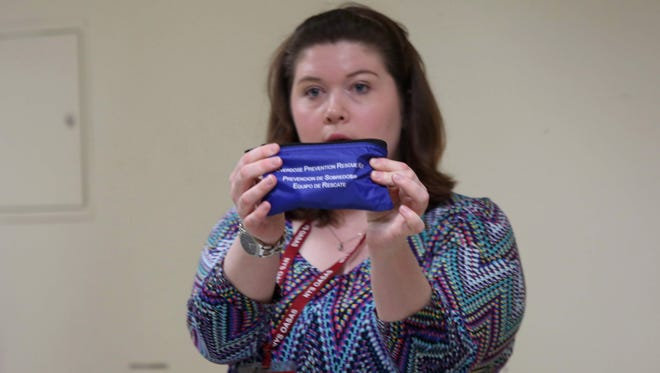 Nurse Tara Kick shows an overdose prevention rescue kit that contains Narcan, a heroin overdose antidote medication, during a training session at Blaisdell Addiction Treatment Center in Orangeburg on March 26, 2015.