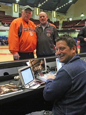 Rob Di Fiore (sitting) plays 'Tonite, Tonite' by The Mello-Kings at the start of each County Center high school game as a request from Jim Bergholtz, left, and Howie Green.
