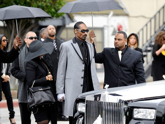 Six months after the Rolls initially disappeared, it resurfaced at the home of  Snoop Dog, left, who rode in it to the funeral of fellow rapper Nate Dogg in Long Beach, Calif. The car vanished again days later.