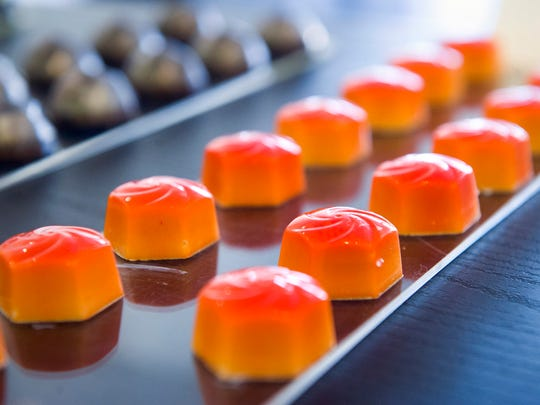 """These """"Sunrise"""" chocolates made by Philip Ashley Rix are flavored with blood orange, anejo tequila, and Mexican vanilla bean. (Brandon Dill/Special to The Commercial Appeal)"""