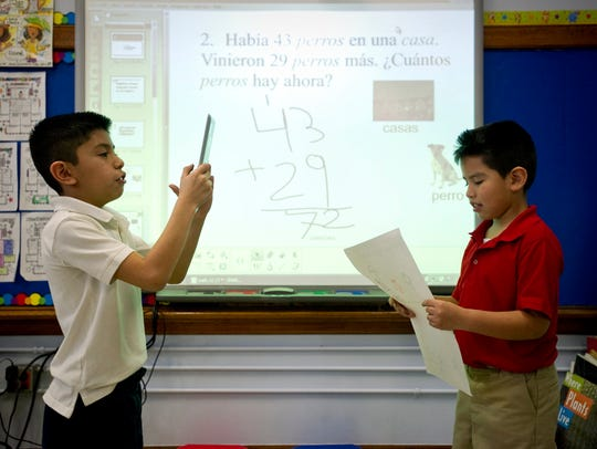 Jan 10, 2014 - Anthony Bolanos, 8, (left) records fellow