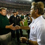 The last time Jim McElwain coached in an SEC title game, it was against LSU in 2012 as a member of Nick Saban's coaching staff. McElwain will square off against his former boss as coach of the Gators on Saturday in the SEC title game.