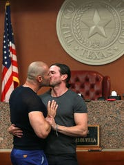 Yairo Herrera, left, and Luke Karam kissed after they were married by Judge Carlos Villa in County Court at Law 5 on June 26, 2015. They were the first same sex couple to be married at the El Paso County Courthouse.