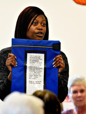 In this file photo, York County Elections and Voter Registration Director Nikki Suchanic emphatically talks to poll workers about the importance of the official voting machine cartridge bag during a training session at the Red Lion Area Senior Center in Red Lion, Pa. on Tuesday, Oct. 20, 2015. Dawn J. Sagert - dsagert@yorkdispatch.com