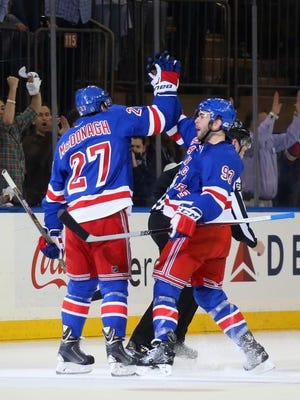 Ryan McDonagh of the Rangers scores a power play goal at 15:16 of the first period against the Pittsburgh Penguins and is joined by Keith Yandle in Game One of the Eastern Conference Quarterfinals during the 2015 Stanley Cup Playoffs at Madison Square Garden on April 16, 2015 in New York City.