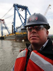 Super crane operator Ronald Burgess of New Rochelle is shown by the Left Coast lifter Oct. 28, 2014. He talked about his role in helping to build the new Tappan Zee Bridge.