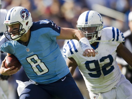 Matt Hasselbeck, quarterback for Tennessee, eludes a pass rush by Jerry Hughes of the Indianapolis Colts at Tennessee Titans, LP Field, Nashville, TN, Sunday, October 28, 2012. Indianapolis won 19-13 in overtime. Robert Scheer/The Star