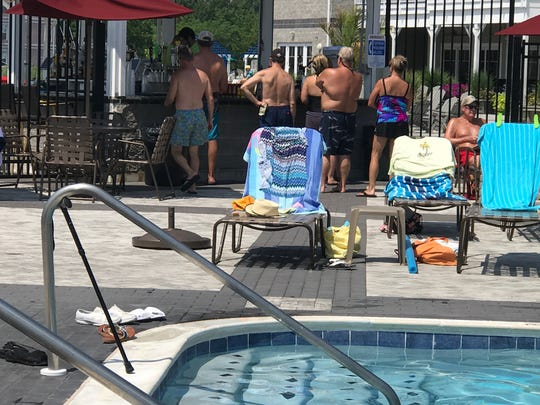 Patrons line up for drinks at the Oasis Pool.