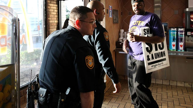 Antonio Cathey, right, at a McDonald's on Union during a protest for higher wages for fast food workers in 2016. Cathey's cousin, James Cathey Jr., was arrested for marijuana possession on Monday.
