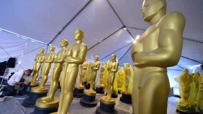 Damon Schindler touches up Oscar statues on Feb. 24, 2016, in Hollywood, Calif.