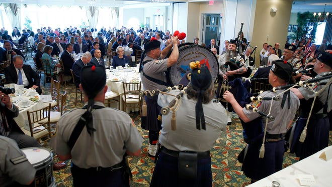 The Monmouth County Police and Fire pipe and drums play at the start of the 200 Club of Monmouth County Annual Valor Awards Luncheon at the Spring Lake Golf Club Friday, June 3, 2016.