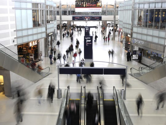 Passengers make their way through the McNamara Terminal