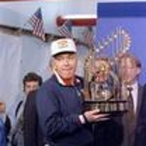 Twins manager Tom Kelly hoists the World Series championship trophy in 1991 after a 1-0 victory over Atlanta in 10 innings in Game 7.