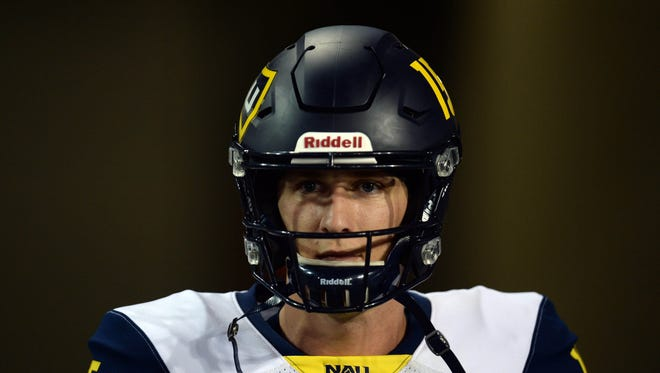 Sep 2, 2017; Tucson, AZ, USA; Northern Arizona Lumberjacks quarterback Case Cookus (15) takes the field prior to facing the Arizona Wildcats at Arizona Stadium. Mandatory Credit: Joe Camporeale-USA TODAY Sports
