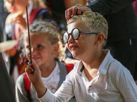 Quinn Sweigart, 6, casts a spell while dressed as Harry