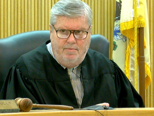 Judge Thomas Scully conducts a hearing in State Superior